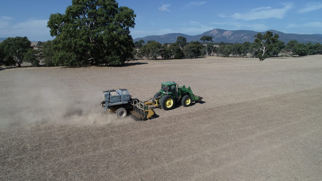 Serafin PastureKing double disc air seeder drone shot